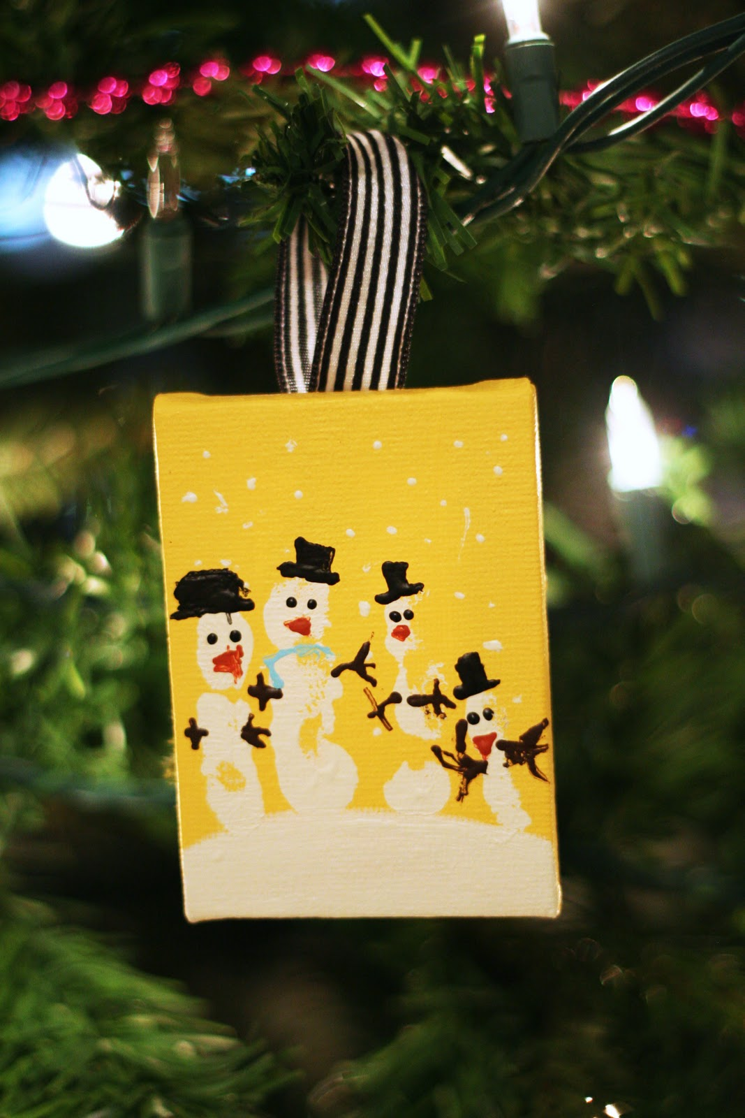 hand print snowman ornaments  Eighteen25