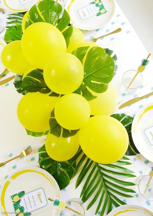 DIY Balloon & Fronds Tropical Party Centerpiece via Birds Party