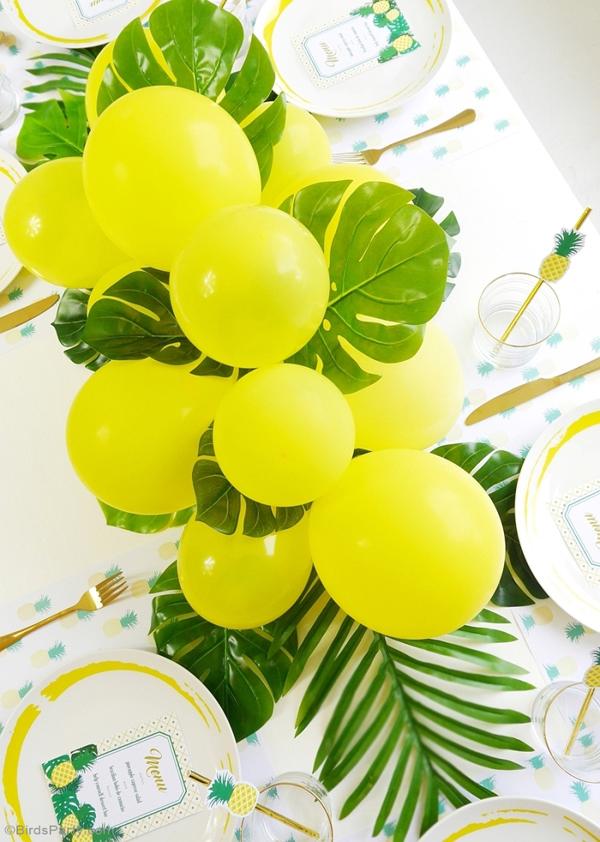 DIY Balloon & Fronds Tropical Party Centerpiece via Birds Party