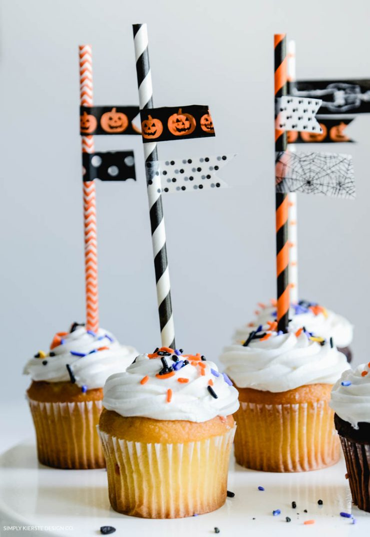 Fun Halloween Cupcake Toppers | Grab those leftover paper straws and some fun washi tape and put together some adorable Cupcake Toppers!