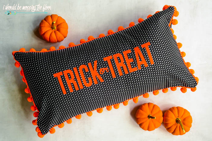 Halloween lumbar-style envelope pillow with pom pom trim