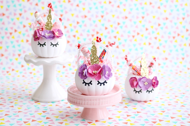 Unicorn Pumpkin Candy Holders. Transform cheap orange pumpkins into these adorable little unicorns!