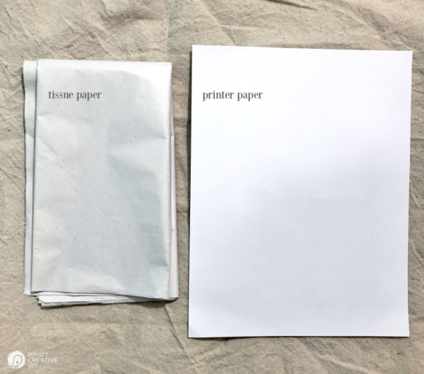 Tissue paper and printer paper set out for project